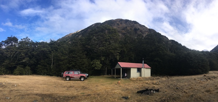 Basins hut with a Birdwood range peak in the background